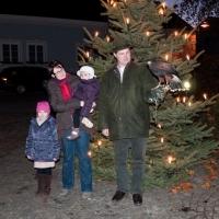 Weihnachtspostkarte: Jagdleiter mit Familie und Wüstenbussard